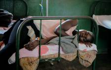 A patient rests on a bed after being discharged from the malaria ward at Panyadoli Health Center III in Kiryandongo. Picture: AFP.