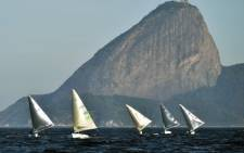 Atheletes of Men's Finn class compete during the first day of Aquece Rio, the International Sailing Regatta 2014, as the first test event for the Rio 2016 Olympic and Paralympic Games  in Rio de Janeiro, Brazil, on 3 August, 2014. Picture: AFP.