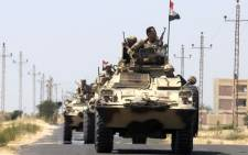 FILE: Armoured personnel carriers (APC) of the Egyptian Army patrol on a road close to El Gorah in northeastern Sinai. Picture: EPA.