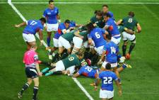 Schalk Brits (16) dives through a ruck of bodies to cross the line and score South Africa's fourth try against Samoa at the RWC2015. Picture: Rugbyworld.com
