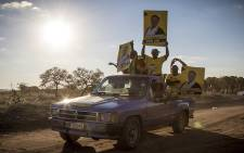 Supporters on a bakkie hold posters with ANC candidates during an unofficial rally in Vuwani and surrounds. Picture: Thomas Holder/EWN.