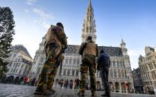 FILE: Soldiers and police patrol on Brussels' Grand Place as the Belgian capital remains on the highest possible alert level on November 23, 2015.Picture: AFP.