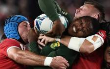Springbok wing S'Busiso Nkosi (C) is tackled by Wales' flanker Justin Tipuric and Wales' fly-half Dan Biggar (R). Picture: EWN