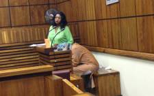 FILE: Sindisiwe Manqele covers her head in court. Picture: Masego Rahlaga/EWN.
