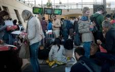 Stranded passengers wait at the Calais-Frethun train station in northern France to cross to the United Kingdom in the early hours of September 2, 2015. Hundreds of passengers were left stranded in dark, stifling Eurostar trains in the early hours after several suspected migrants climbed onto the tracks near the French port of Calais. Picture: AFP