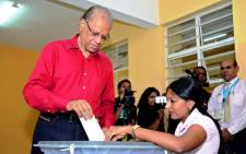 Prime Minister Navinchandra Ramgoolam votes for the parliamentary elections at a polling station in Port Louis on 10 December, 2014. Picture: AFP.""