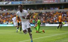 Chelsea striker Tammy Abraham (C) celebrates after scoring their fourth goal, his third during the English Premier League football match between Wolverhampton Wanderers and Chelsea at the Molineux Stadium in Wolverhampton, central England on 14 September 2019. Picture: AFP