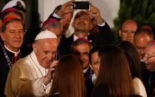 Pope Francis greets the faithful during an event at the Nunciature in Bogota on 7 September 2017. Picture: AFP