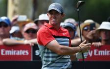 FILE:Rory McIlroy of Northern Ireland tees off at the 16th hole during the final round of the Australian Open golf tournament at the Australian Golf Club in Sydney on 30 November 2014. Picture: AFP.