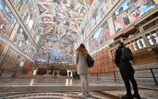People visit the Sistine Chapel on the reopening day of the Vatican museum on February 1, 2021 in Vatican City, as the city-state eases its closure aimed at curbing the spread of the COVID-19 infection, caused by the new coronavirus. Picture: Andreas Solaro / AFP.