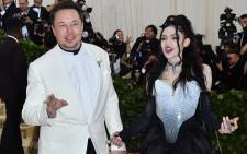 In this file photo taken on 7 May 2018 Elon Musk and Grimes arrive for the 2018 Met Gala, at the Metropolitan Museum of Art in New York. Picture: AFP