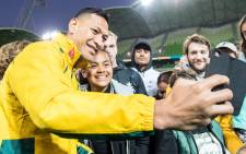 Livewire fullback Israel Folau celebrates Australia's victory against Fiji with fans in Melbourne. Picture: Twitter/@qantaswallabies.