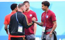 England's midfielder Dele Alli (R) greets Belgium's defender Toby Alderweireld before their Russia 2018 World Cup play-off for third place football match between Belgium and England at the Saint Petersburg Stadium in Saint Petersburg on 14 July 2018. Picture: AFP.