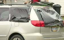 A screengrab of a vehicle damaged by vandalism.