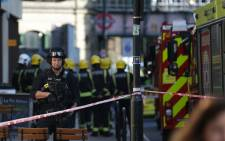 Armed British police officers stand on duty outside Parsons Green underground tube station in west London on September 15, 2017, following an incident on an underground tube carriage at the station. Picture: AFP