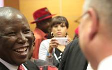 EFF leader Julius Malema laughs while he talks with his legal council after his fraud and corruption trial was struck off the roll in the High court sitting in Polokwane on 4 August 2015. Picture: Reinart Toerien/EWN.