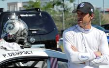 FILE: US actor Patrick Dempsey gets ready prior to the Porsche Cup practice session ahead of the German Formula One Grand Prix in July 2014. Picture: AFP.