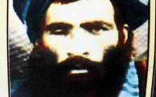 FILE: This picture taken in Kandahar on July 31, 2015 shows a calendar bearing the image of the Afghan Taliban's deceased leader Mullah Omar. Picture: AFP