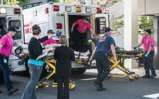 A patient is taken into the emergency room at Mercy Medical Center in Roseburg, Oregon, after a deadly shooting at Umpqua Community College on 1 October 2015 in which 10 people were killed. Picture: AFP/Aaron Yost/The News-Review.