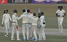 South Africa's George Linde (C) celebrates with teammates after taking the wicket of Pakistan's Faheem Ashraf (not pictured) during the third day of the second Test cricket match between Pakistan and South Africa at the Rawalpindi Cricket Stadium in Rawalpindi on February 6, 2021. Aamir Qureshi / AFP.