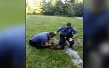 [WARNING GRAPHIC VISUALS] Viral video shows officers restraining 9-year-old boy.