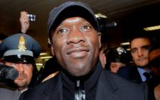 Former Dutch football player and new AC Milan coach Clarence Seedorf arrives at Linate airport in Milan on January 15, 2014. Seedorf is taking over as coach of AC Milan, replacing Massimiliano Allegri. Picture: AFP