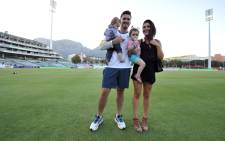 FILE: Graeme Smith and his wife, Morgan Smith, pose with their daughters on the pitch on day five of the third Test match between South Africa and Australia at Newlands in Cape Town on 5 March 2014. Picture: AFP.