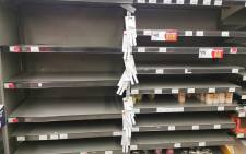 Shelves at a local Pick n Pay emptied after shoppers stockpiled purchases. Picture: Cindy Poluta/EWN.