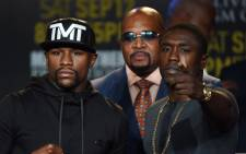 Boxers Floyd Mayweathe and Andre Berto face off during a press conference to officially announce their September 12 fight that will place at the MGM Grand Garden Arena in Las Vegas, at the Marriott Hotel in Los Angeles, California on 6 August 2015. Picture: AFP.