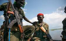 FILE: Sudan People Liberation Army (SPLA) soldiers ride on a boat on the Nile river on their way to Aleleo, Fashoda State. Picture: AFP.
