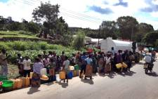 Residents of Blantyre queue for safe drinking water on 21 January 2015 after floods contaminated the local water supply. Picture: Aletta Gardner/EWN