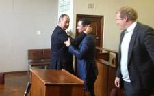 Carl Pistorius hugs his lawyer Kenny Oldwage after being acquitted on all charges on 21 May 2013. Picture: Shain Germaner/EWN