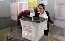 An Egyptian voter casts her vote in a polling station in the capital Cairo's eastern neighbourhood of Heliopolis on the first day of the 2018 presidential elections on 26 March, 2018. Picture: AFP