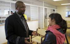 Chief Mfundo Mtirara at Mthatha Airport seen here with Rahima Essop from EWN. Picture:Renée de Villiers/EWN