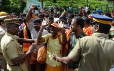 Indian Hindu devotees and activist take part in a protest against the Supreme Court verdict revoking a ban on women's entry to Sabarimala's Ayyappa Hindu temple, in Nilackal in southern Kerala state on 17 October, 2018. Picture: AFP