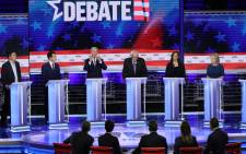 FILE: Democratic presidential candidates (L-R) former tech executive Andrew Yang, South Bend, Indiana Mayor Pete Buttigieg, former Vice President Joe Biden, Sen. Bernie Sanders (I-VT), Sen. Kamala Harris (D-CA) and Sen. Kirsten Gillibrand (D-NY) take part in the second night of the first Democratic presidential debate on 27 June 2019 in Miami, Florida.