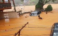 This handout picture released on 14 August 2017, by Society 4 Climate Chnage Communication Sierra Leone, shows flooded streets in Regent near Freetown. Picture: AFP.