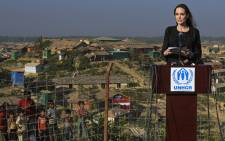 US actress, filmmaker and humanitarian Angelina Jolie, a special envoy for the United Nations High Commissioner for Refugees (UNHCR), addresses a press conference as young Rohingya refugees (L) watch, after her visit to the Kutupalong camp for Rohingya refugees in Ukhia in southern Bangladesh on 5 February 2019. Picture: AFP