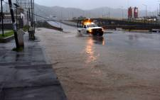 A truck drives along a flooded street in Manzanillo, Colima state, Mexico on 23 October, 2015, during hurricane Patricia. The strongest hurricane ever recorded crashed into Mexicos Pacific coast on Friday, ratcheting up fears that super-storm Patricia will unleash death and destruction with its powerful winds and driving rain. Picture: AFP.