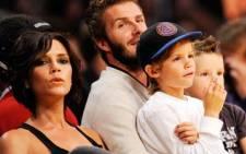 David Beckham and his wife Victoria. AFP