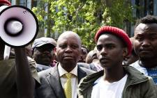 Johannesburg Mayor Herman Mashaba accepts a memorandum from students outside the city's chambers on 27 September 2018. Picture: Kayleen Morgan/EWN