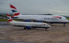 British Airways' Boeing 737-800 (front) alongside their new A380 airbus (back). Picture: Supplied
