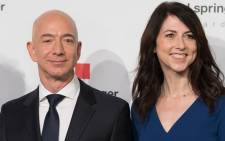 Amazon CEO Jeff Bezos and his wife MacKenzie Bezos poses as they arrive at the headquarters of publisher Axel-Springer where he will receive the Axel Springer Award 2018 on 24 April 2018 in Berlin. picture: AFP