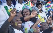 People wave flags around during Youth Day celebrations at the Orlando stadium in Soweto during Youth Day commemorations on 16 June 2016. Picture: Reinart Toerien/EWN.