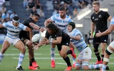 Argentina's Matias Alemanno (2nd R) tackles New Zealand's Caleb Clarke (C) during their 2020 Tri-Nations rugby match at Bankwest Stadium in Sydney on 14 November 2020. Picture: AFP