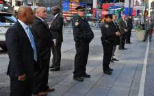 Police from different agencies, stand guard as New York Mayor Bill de Blasio holds a news conference in Times Square 7 November, 2016 to discuss Election Day security preparations. Picture: AFP.