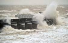 Large waves crash into Brighton Marina on the southern coast of England, on February 5, 2014. Stormy weather across southern Britain has left thousands of homes without power and transport networks in chaos. Picture: AFP.