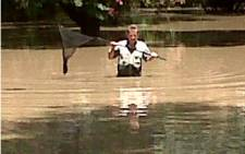 FILE: A Vaal River resident on his front lawn after heavy rains cause flooding in the area. Picture: Samantha Richardson/iWitness.