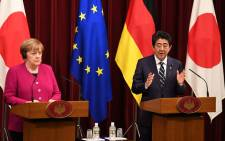 German Chancellor Angela Merkel (L) and Japanese Prime Minister Shinzo Abe (R) attend a joint press conference following their meeting at Abe's official residence in Tokyo on 4 February 2019. Picture: AFP