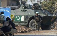 Pakistani security personnel take position outside an Agriculture Training Institute after an attack by Taliban militants in Peshawar on 1 December 2017. Picture: AFP
